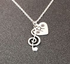 A personal favorite from my Etsy shop https://www.etsy.com/listing/208919800/music-jewelry-treble-clef-necklace-music