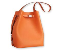 In love with Peter Kent bags. Gorgeous orange.
