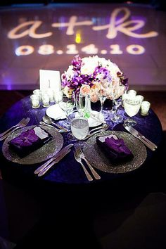 Personalized lighting, mood lighting in our colors, reasonable/ low centerpieces, lightly-larger-than-tealight candles on the tables, matching linens... PERFECT sweetheart table! (Don't necessarily care for the purple napkins and extravagant charger plates.)