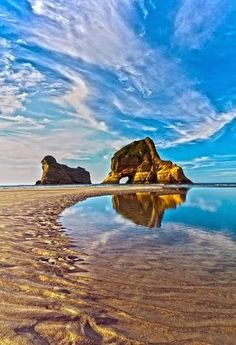 Wharariki Beach, Golden Bay, New Zealand. Here you can explore the wild and rugged northern point. (Beauty Scenery New Zealand) Places Around The World, Oh The Places You'll Go, Places To Travel, Places To Visit, New Zealand Travel, Adventure Is Out There, Belle Photo, Wonderful Places, Amazing Places