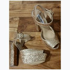 Gold Steve Madden Heels Sparkly gold Steve Madden heels. Perfect for a New Years party or a night out. They are in perfect condition. Only tried them on around the house. Steve Madden Shoes Heels