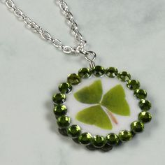 How to make a shamrock pendant! Cool idea to save the kids 4 leaf clovers when they hunt this spring