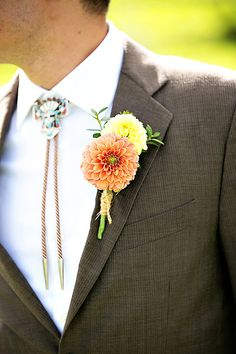 A bolo tie and rustic boutonniere-- so country! {Tiffany Rebeeca Photography}
