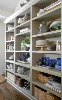I absolutely love these open shelves in the dining room. The clean lines are more appealing to me than a traditional hutch or buffet.