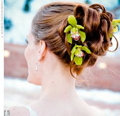 Wedding Updo  Beth's hairstylist curled her hair and twisted it into sections, securing each piece with a hairpin. For a natural touch, she added three white orchids the couple's florist had provided