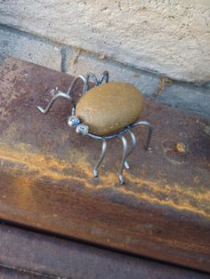 Small Spiders metal yard art made from scrap metal and TIG welded. Looks right at home on our rusty steel scrap pile. Has a smooth local river rock as Art sur Métal Metal Yard Art, Metal Tree Wall Art, Scrap Metal Art, Metal Artwork, Tree Artwork, Metal Sculpture Artists, Steel Sculpture, Sculpture Ideas, Art Sculptures