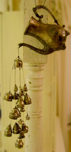 Next time I see an old teapot for a super-cheap price at the thrift store, I wanna make a Teapot Windchime for my garden. Only, I might use old, mismatched tea spoons for the chimes... maybe I could hang them from an upside-down tea cup!