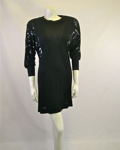 "Vintage Jean Muir Black Mutton Sleeve Dress. ""Mid 1980s sequinned evening dress; mid-thigh length; shoulder pads; single button fastening to back neck-line; unlined; viscose."