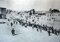 This photograph shows the men in Kharpert being marched out of their village by the Turkish soldiers.
