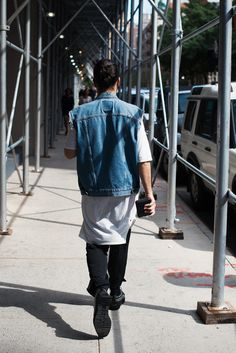 Yep, that's NYC style. Easy cool look!  Also, love how he mixed Prada shoes with vintage denim vest.