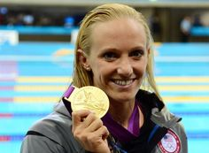 Dana Volmer not only gets gold in the 100 Meter butterfly for USA but she set a new world record of 55.98!