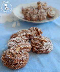 Biscotti di frolla montata alla nutella buonissimi golosi friabili uguali a quelli che vendono in pasticceria,anzi fatti da noi sono ancora più buoni