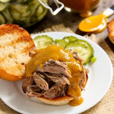 """Slow cooked pork, fork-tender and saturated with flavor, is one of my favorite dishes of all time. Today I'm sharing this wonderful Slow Cooker Island Pulled Pork recipe from Jill Holland, Chef Instructor atSecond Harvest Food Bank of Central Florida. This recipe is included in the just released slow cooker cookbook """"Where Slow Food and …"""