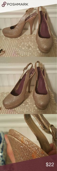 High heels 5-inch high heels with gold sparkles. There is an orange stain near one of the heels (shown in photo) but it's not noticeable when they are worn. Madden Girl Shoes Heels