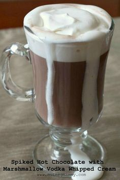 This spiked hot chocolate with marshmallow vodka whipped cream is the perfect cold winter day cocktail. Comforting and delicious. You'll love this!