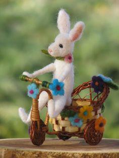 Needle felted white bunny riding bike