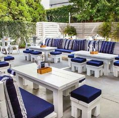 Wow....Sturdy pallet patio furniture painted white. Stools slide under tables for storage. Love the coordinating backdrop with ferns hanging! Backdrops would be awfully heavy--but once in place really dont have to move them except to power wash & repaint them every other year or so.