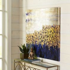 "Though we've titled it ""Unassuming,"" our remarkable, hand-painted canvas will have quite an impact on your living, dining or bedroom areas. With its interplay of deep indigo, gold and silver, this artwork is ready to bring a dramatic counterpoint to modern and traditional styles alike."