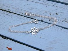 Our sterling silver Flower bracelet is a delicate, stylish and contemporary statement. The perfect wedding gift to the flower girl at your wedding or as the ideal first communion or confirmation souvenir. Simple and versatile, perfect for everyday wear. Sterling Silver Flowers, Sterling Silver Jewelry, Silver Gifts, Flower Bracelet, Confirmation, Link Bracelets, Communion, Perfect Wedding, Wedding Gifts