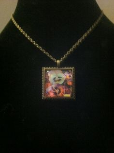 Square brass tone pendant with pansy by TheKnottyGirlHookery, $45.00