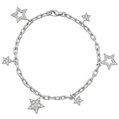 Tiffany & Co. Platinum & Diamond Star Charm Bracelet | From a unique collection of vintage charm bracelets at http://www.1stdibs.com/jewelry/bracelets/charm-bracelets/