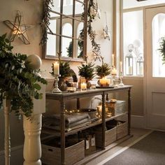 Rustic Decor Of Shelf With Candles And Christmas Greenery