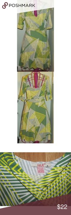 """ISLE Wrap style DRESS stretch size S M Lovely ISLE dress in size M - this may fit a S if you lean more toward M than XS. Short sleeves that are a little longer in length (not quite 3/4). Cross V neckline. Tie belt. A lot of stretch for a semi-form fit. Looks great on. Geometric print, but looks sort of tropical. Colors of green, yellow & white. Interesting circle scoop design on back. Measures about 39"""" long, -and 17""""-19"""" across the front under the arms (this can be adjusted more or less…"""