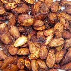 Cajun Spiced Roasted Pumpkin Seeds Recipe Spiced Pumpkin Seeds - Use mix of pumpkin, sunflower, almonds and cashews and replace butter with organic canola or olive oil to get loads of healing Copper, Vitamin E, Magnesium and Phosphorus Flavored Pumpkin Seeds, Best Pumpkin Seed Recipe, Savory Pumpkin Seeds, Homemade Pumpkin Seeds, Pumpkin Seed Recipes, Toasted Pumpkin Seeds, Roast Pumpkin, Pumpkin Spice, Hors D'oeuvres