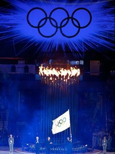 The Olympic Flag is passed on  Boris Johnson, Mayor of London watches as Jacques Rogge, President of the International Olympic Committee, presents the Olympic flag to Eduardo Paes, Mayor of Rio de Janeiro during the Closing Ceremony of the Olympic Games