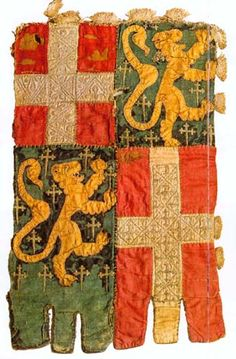 photo of the 14th century banner with the arms of the dukes of Savoy with the family arms of de Blonays, in a combination of appliqué and embroidery