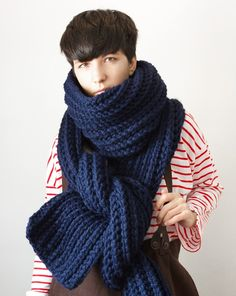 i'm obsessive compulsive when it comes to anything knitted or crocheted. this extreme scarf from yokoo on etsy is no exception.  http://www.etsy.com/listing/59541621/the-snow-leopard-in-navy-chunky-scarf