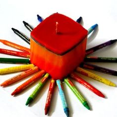 How to make crayon candles via @Guidecentral - Visit www.guidecentr.al for more #DIY #tutorials