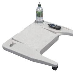 The purpose of this device to provide an attachable lap top desk on to any wheelchair. It provides storage for personal items and a durable plastic clip to hold an open book or newspaper. It can lie flat to allow a work surface and the adjustable lid tilts forward to allow reading and writing. The tray can hold up to seven pounds.