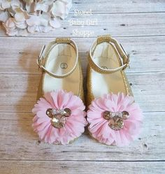 These Gold Minnie Mouse shoes are perfect for her Pink and Gold Minnie Mouse First Birthday Outfit! They are a gold glitter slip on shoe with adjustable ankle straps. Weve attached pink chiffon flowers to the tops and added adorable sparkling gold Minnie Mouse buttons wearing