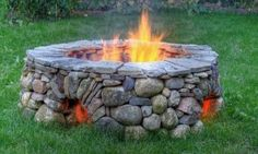 This fire pit--love the vents! Use kit structure. Face exterior like this pit add 3 flat triangular pieces as tines to set bbq grill on! Set in round crushed limestone patio. Add stone seating. Tabletop cover for fire season.