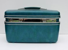 Vintage Samsonite train case. Not only did I receive this from my neighbors when I graduated from high school, I still have it and I use it everyday as my makeup case.