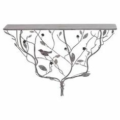 "Metal wall shelf with a twisted tree branch base and silver finish.   Product: Wall shelfConstruction Material: MetalColor: SilverDimensions: 16"" H x 24"" W x 8"" D"
