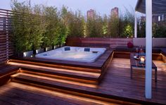 Outdoor hot tub with lighting Wood decking