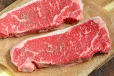 raw strip steaks on parchment paper Beef Loin Strip Steak Recipe, New York Steak Recipe, Pork Loin Recipes Oven, Steak Recipes, Crockpot Recipes, Keto Recipes, Cooking Spiral Ham, Oven Cooking, Cooking The Best Steak