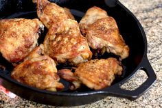 These crispy skinned baked chicken thighs are made with only 2 ingredients! Sear them in a heavy skillet and then finish them in the oven.