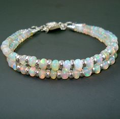 This double strand bracelet is a knockout.! It combines AAA Ethiopian Fire Opal rondelles and Sterling Silver rondelles. There is a total of 102