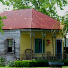 Creole plantation building. Louisiana plantation. By Ann Stewart