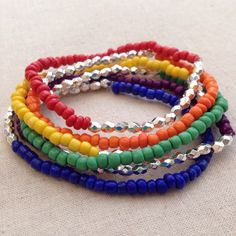 This pride bracelet is made with stretch cord, which is easy to put on and take off. Each bracelet has a different glass seed bead color - red, orange, yellow, green, blue and violet. The silver hexagonal beads add a little sparkle.