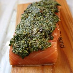 """""""Quick, simple and loaded with flavor! This Kale, Garlic and Pesto topped @sizzlefishfit Sockeye Salmon from @bendifulblog is the perfect week night meal that can be made in minutes!  - - Thank you @bendifulblog for tonight's dinner inspiration!  - -  @sizzlefishfit #omegas #poweredbyfish #sizzlefishfit #lunch #dinner #inspiration #healthy #health #eatclean #cleaneats #iifym #macros #paleo #lean #weightloss #diet #fitness #endurance #workout #muscle #fitfam #fitfood"""
