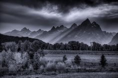 Late light peaking through the Tetons | by diana_robinson   | Are you planning a trip to Grand Teton National Park? Take Chimani with you! www.chimani.com/#grandteton We develop 100% free mobile app travel guides for national parks and other outdoor destinations. No cell connection required! Download our apps for iOS and Android at www.chimani.com or in the App Store or on Google Play