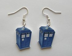 Dr Who Tardis (Police Call booth) Earrings. Hand made Dr Who Tardis (Police Call Booth) earrings. These earrings are made of a durable plastic, charms are flat not Image is on front side only back side is white. Police Call, Police Box, Doctor Who Tardis, Don't Blink, Blue Box, Geek Out, Dr Who, Geek Chic, At Least