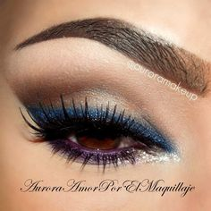 Deep blue and purple cat eye, not loving these fake eyebrows though : / or any of them in that fact