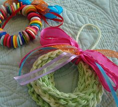 Simple wreath ornament - crochet one long chain, then loop it up & tie.  Great for beginners!