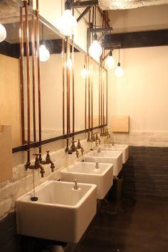 Interior industrial rustic on pinterest restaurant for Restaurant bathroom design ideas