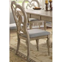 One Allium Way This dining chair will create an elegant look for your dining room. Design attributes like turned legs, fabric cushion seating and antique white finish, traditional touch that adds charm to this collection. French Country Dining Chairs, White Dining Room Chairs, French Country Furniture, French Country Living Room, Solid Wood Dining Chairs, Dining Arm Chair, Dining Room Bar, French Country Decorating, Upholstered Dining Chairs